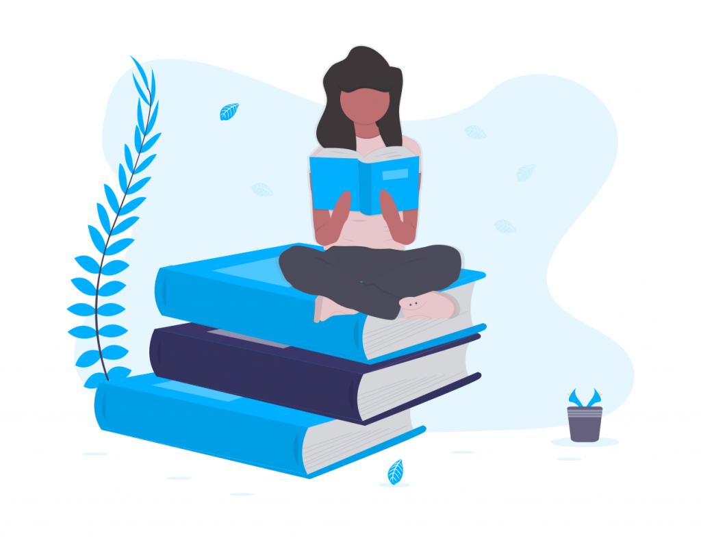 本の上で本を読む女性