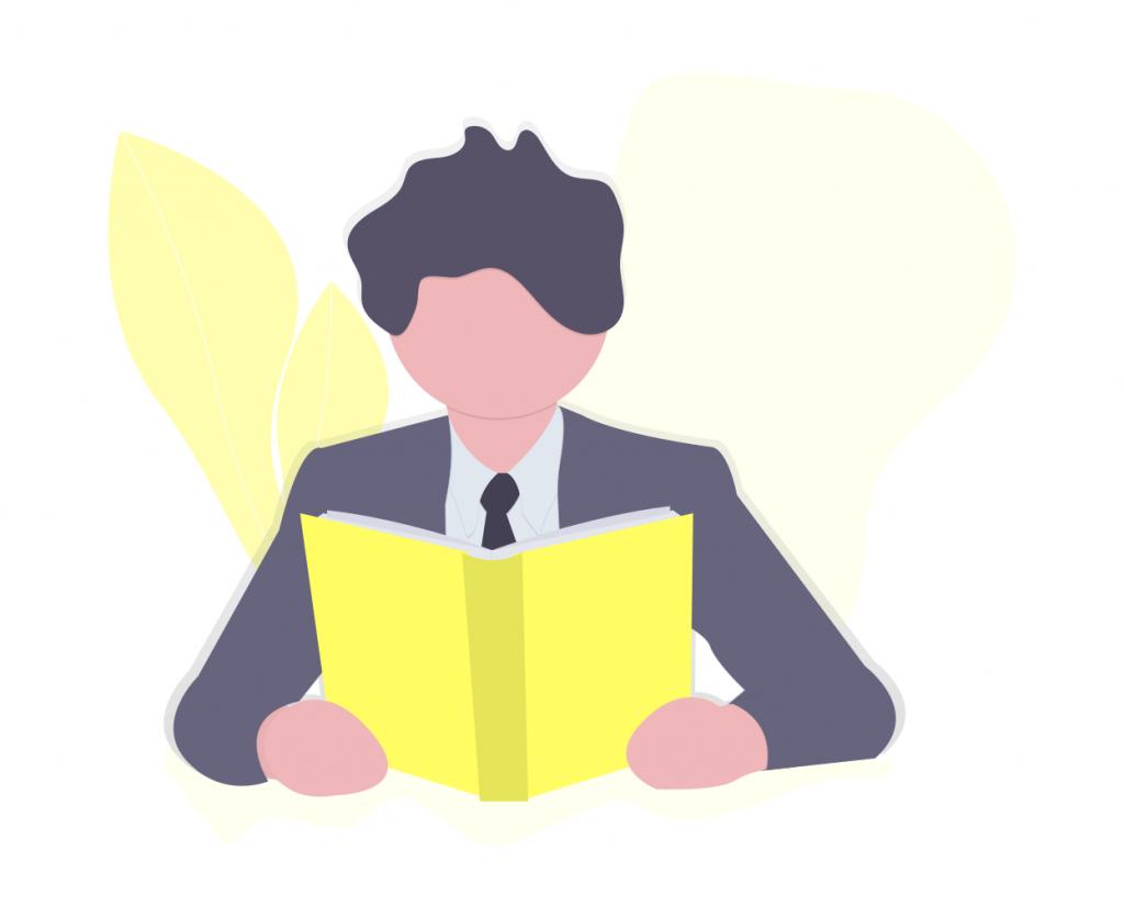 黄色い本で勉強する男性