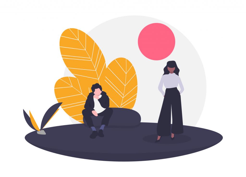 座る男性と立つ女性