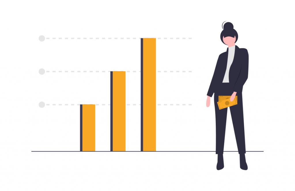 グラフの横に立つ女性