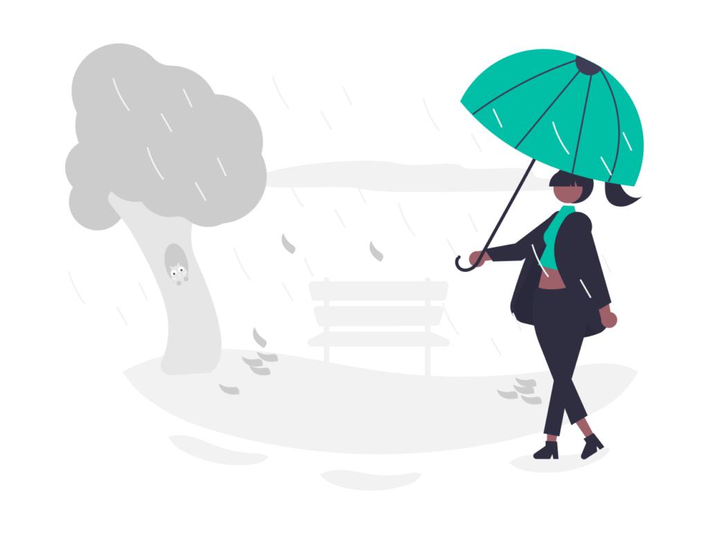 雨の中傘をさしている女性
